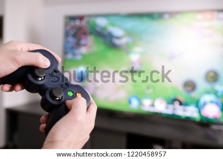 d971c71036e7 Man happy playing video games with virtual reality. He having fun with  console online.