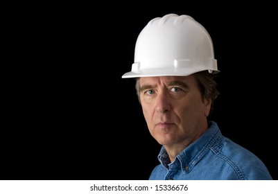 Man in Hard Hat against black background with copy space
