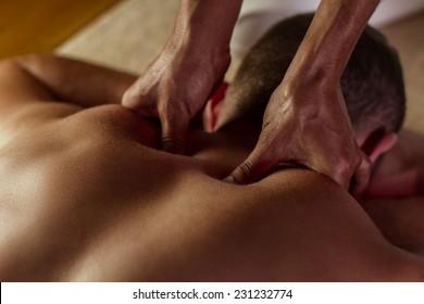 Man has deep tissue massage on the back.