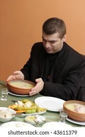 The man has early breakfast - Armenian National dish hash soup