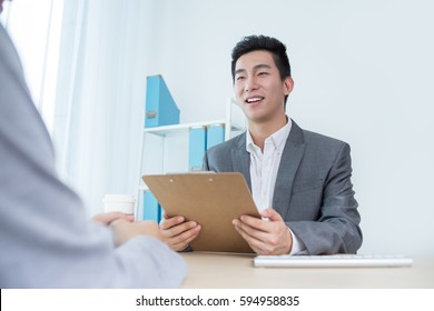 man has meeting with co-worker or Interview