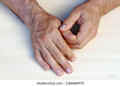 A man has pain in his hands and fingers