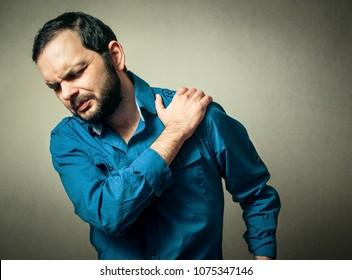 Man has the shoulder pain