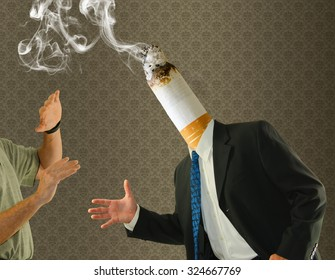 A man has a stinky smoking cigarette butt for a head representing the disgusting habit. Smoking cessation and motivational photo using humor.