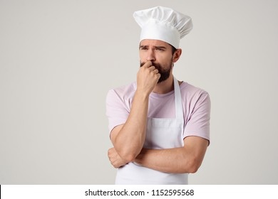 a man in a hat and apron was thinking about something