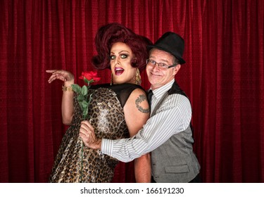 Man in hat attracted to drag queen
