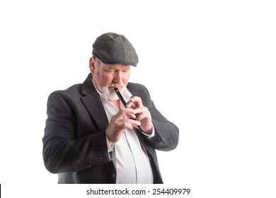 A man in a hat and blazer playing an Irish penny whistle, isolated on a white background