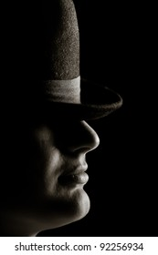 The man with the hat. On a black background