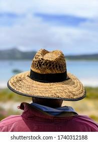 Man in hat relaxing in the sun