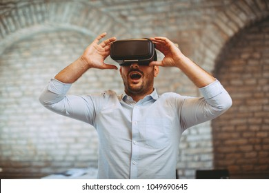 Man have fun with Virtual Reality VR Headset BOX