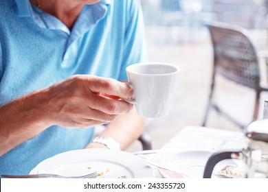 Man have a lunch time and drinks his coffee
