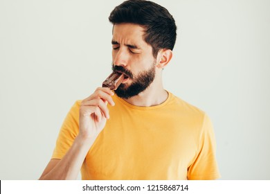 Man have sensitive teeth with ice on white background