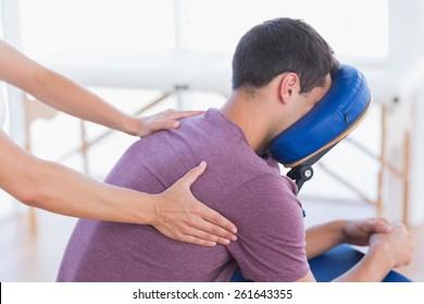 Man having back massage in medical office