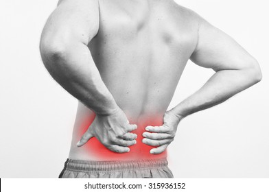 Man having a backache isolated on white