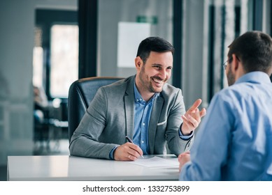 Man having a business meeting and signing a contract, recruitment or agreement.