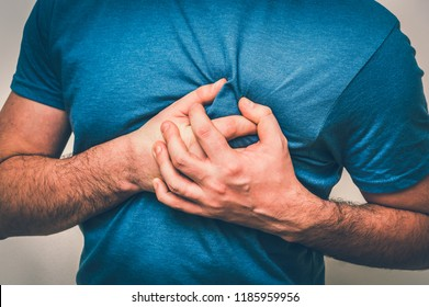 Man having chest pain, heart attack - body pain concept - retro style