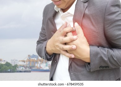 Man having chest pain, heart attack, Concept with Healthcare And Medicine