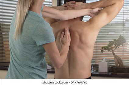 Man having chiropractic adjustment. Osteopathy, Alternative medicine, pain relief concept. Physiotherapy, sport injury rehabilitation