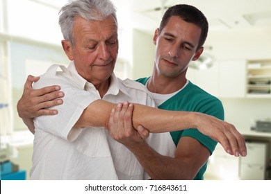 Man having chiropractic arm adjustment. Osteopathy, Alternative medicine, pain relief concept. Physiotherapy, sport injury rehabilitation