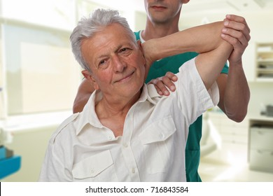 Man having chiropractic back and arm adjustment. Osteopathy, Alternative medicine, pain relief concept. Physiotherapy, sport injury rehabilitation