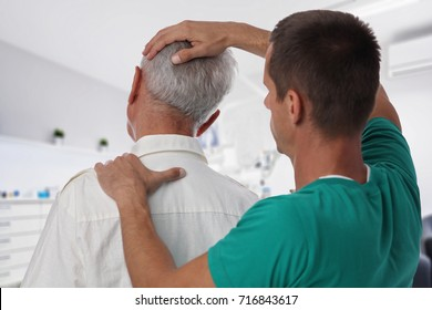 Man having chiropractic back and neck adjustment. Osteopathy, Alternative medicine, pain relief concept. Physiotherapy, sport injury rehabilitation