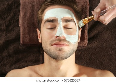 Man having cosmetic mask in spa salon