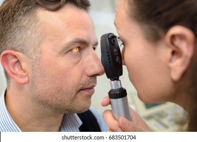 man having eye test eye test machine