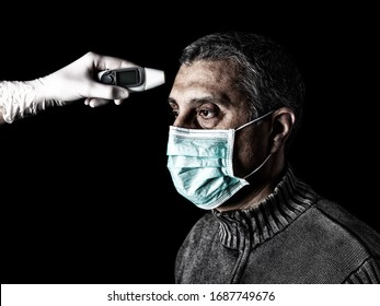 man having the fever measured or taken with digital thermometer by nurse. Pandemic or epidemic, scary, fear or danger concept. Protection for biohazard like COVID-19 aka Coronavirus.