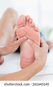 Man having foot massage in medical office