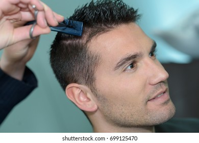 Man having hair trimmed