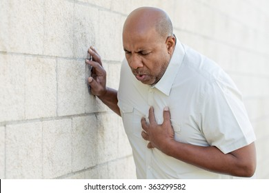 Man having a heart attack.