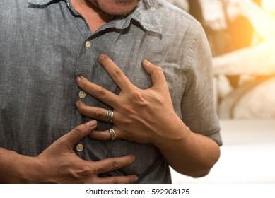 Man having a heart attack.