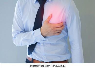 Man having heart-attack / chest pain in isolated background