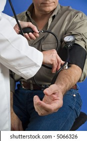 A man having his blood pressure taken by a person in a white lab coat.