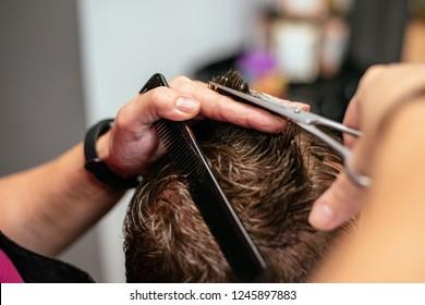 Man having his hair cut in a barbershop