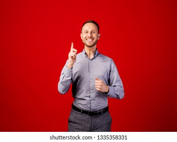 Man having an idea. emotions, facial expressions, feelings, body language, signs. image over red background. people and emotion concept.