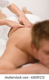 Man having luxury back massage in spa center