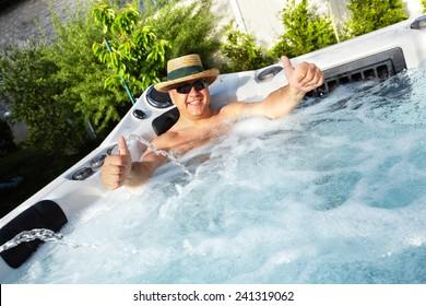 Man having massage in  hot tub Jacuzzi. Spa background.