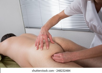 Man having a massage  on the  buttocks