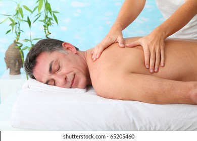 Man having a massage in a spa center