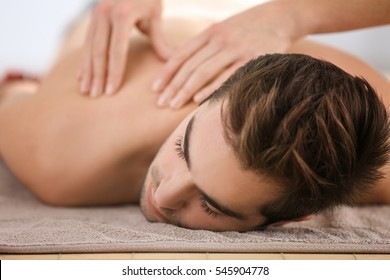 Man having massage in spa salon