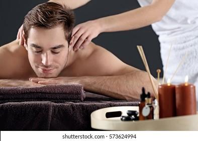 Man having massage in spa salon