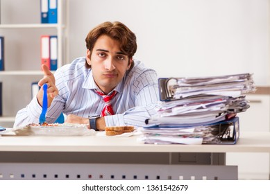 Man having meal at work during break