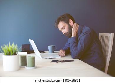 Man having neck ache.