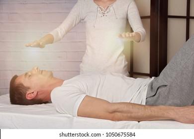 Man having reiki healing treatment , alternative medicine concept.