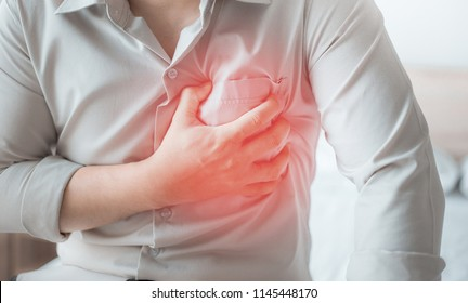 Man having severe chest pain, suffering from heart attack.