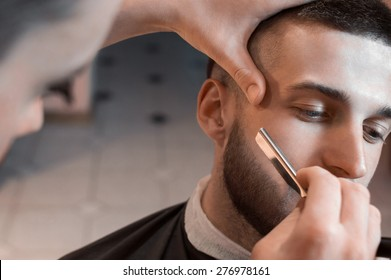 Man having a shave at the barber shop.