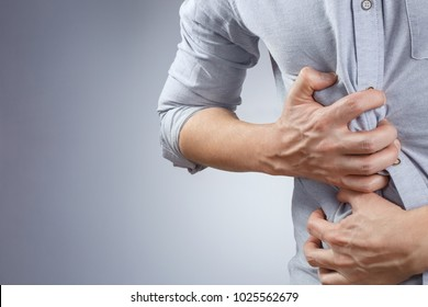 Man having a stomach ache on white background