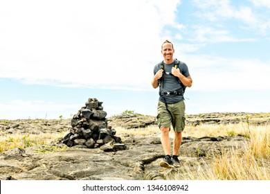 Man at the Hawaii Volcano National Park, Pu u Loa petroglyphs, amazing walk into the past.