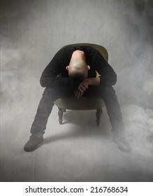 man with head down sleeping in a cloud of smoke